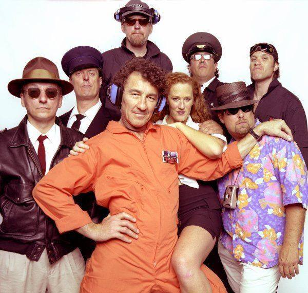 Members of the Tubes standing in two rows, half with sunglasses on